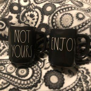 Rae Dunn black mugs.